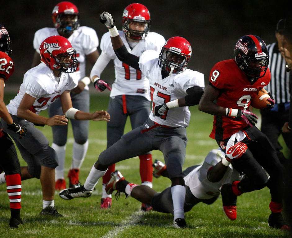 Description of . Seaside's Kordell Reed is forced out of bounds by a Skyline player on a carry during football in Seaside, Calif. on Friday September 6, 2013. Photo David Royal/ Monterey County Herald)