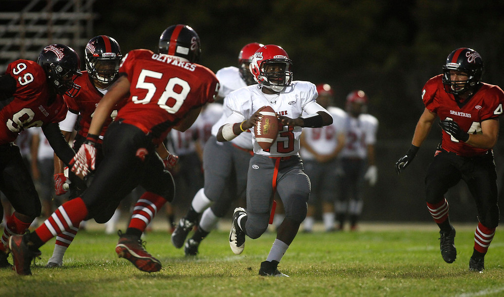 Description of . Seaside defenders surround Skyline quarterback Sid Smith during football in Seaside, Calif. on Friday September 6, 2013. Photo David Royal/ Monterey County Herald)