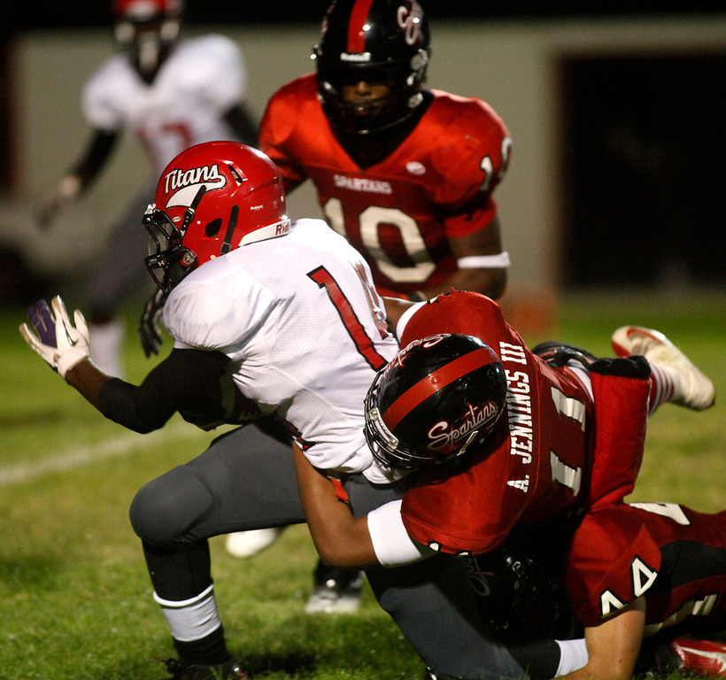 Description of . Seaside's Andy Jennings III. top, and Colby Ostberg tackle Skyline's Armand Shyne during football in Seaside, Calif. on Friday September 6, 2013. Photo David Royal/ Monterey County Herald)