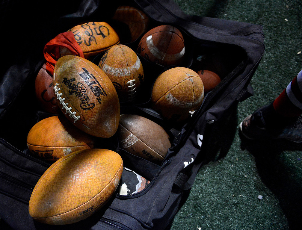 Description of . A bag of footballs sit on Seaside's sideline during football at Salinas on Friday October 18, 2013. (Photo David Royal/ Monterey County Herald)