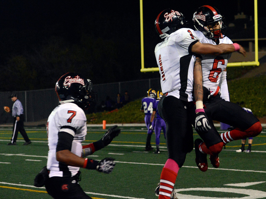 Description of . Seaside quarterback Lorenzo Johnson hugs Ronald Turner after Turner reeled in a touchdown pass during football at Salinas on Friday October 18, 2013. (Photo David Royal/ Monterey County Herald)