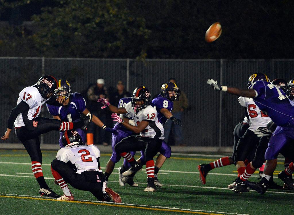 Description of . Seaside's Edwin Hernandez kicks an extra point during football at Salinas on Friday October 18, 2013. (Photo David Royal/ Monterey County Herald)