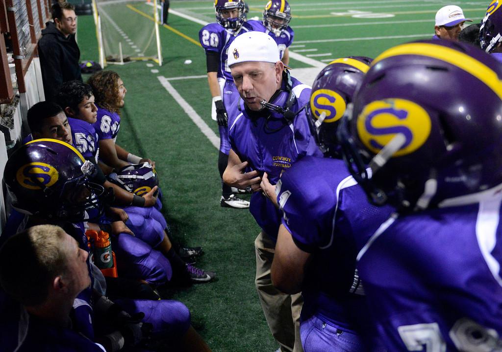 Description of . Salinas players receive coaching during football at Salinas on Friday October 18, 2013. (Photo David Royal/ Monterey County Herald)