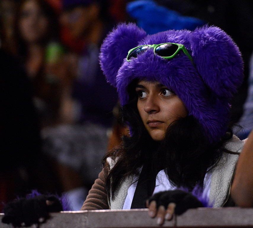Description of . Salinas fan Jaqueline Gastelum watches during football against Seaside at Salinas on Friday October 18, 2013. (Photo David Royal/ Monterey County Herald)