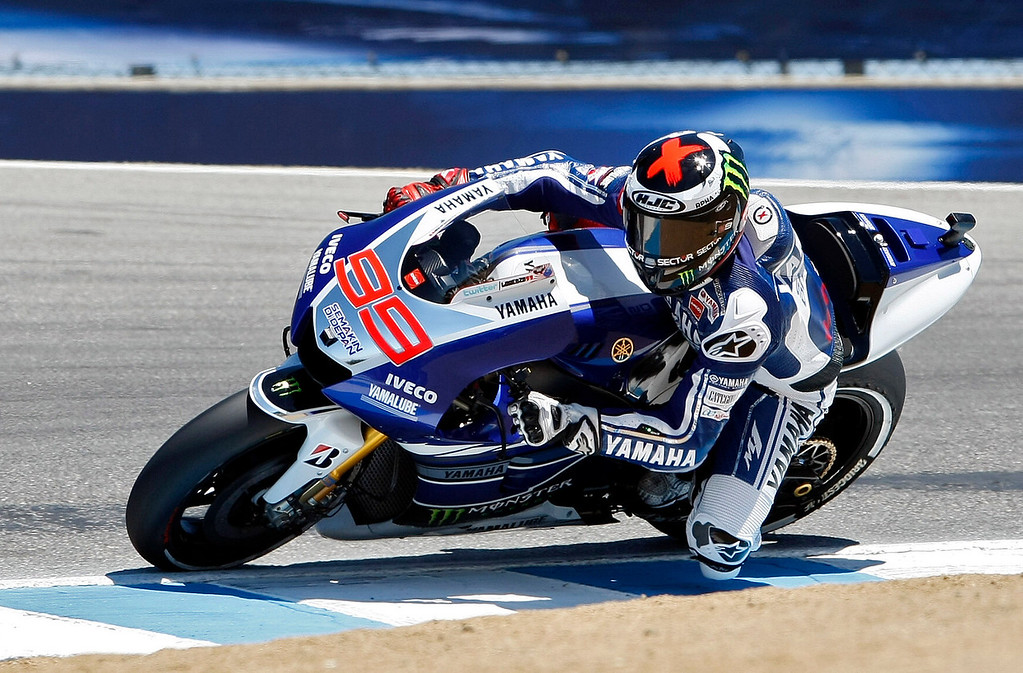 Description of . MotoGp rider Jorge Lorenzo from Spain, heads in to the corkscrew at Mazda Raceway Laguna Seca during the first day of practice on July 19, 2013.  (Vern Fisher/Monterey County Herald)