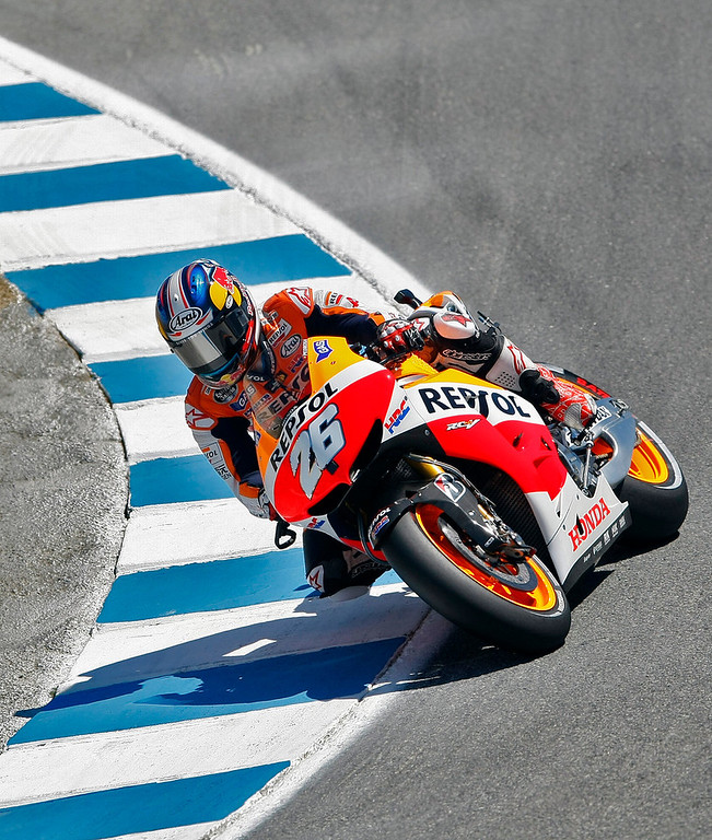 Description of . MotoGp rider Dani Pedrosa from Spain in the corkscrew at Mazda Raceway Laguna Seca during the first day of practice on July 19, 2013.  (Vern Fisher/Monterey County Herald)