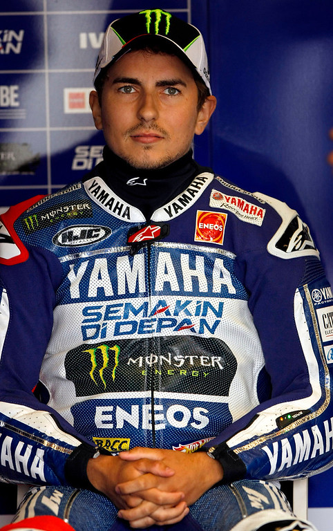 Description of . Jorge Lorenzo from Spain sits in the Yamaha Factory Team garage at Mazda Raceway Laguna Seca during the first day of practice on July 19, 2013.  (Vern Fisher/Monterey County Herald)