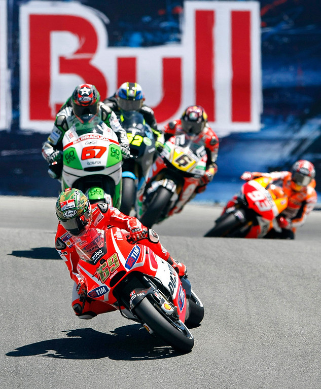 Description of . MotoGp riders #69 Nicky Hayden #67 Bryan Staring, #52 Lucas Pesek, #6 Stefan Bradl and #93 Marc Marquez through the corkscrew at Mazda Raceway Laguna Seca during the first day of practice on July 19, 2013.  (Vern Fisher/Monterey County Herald)