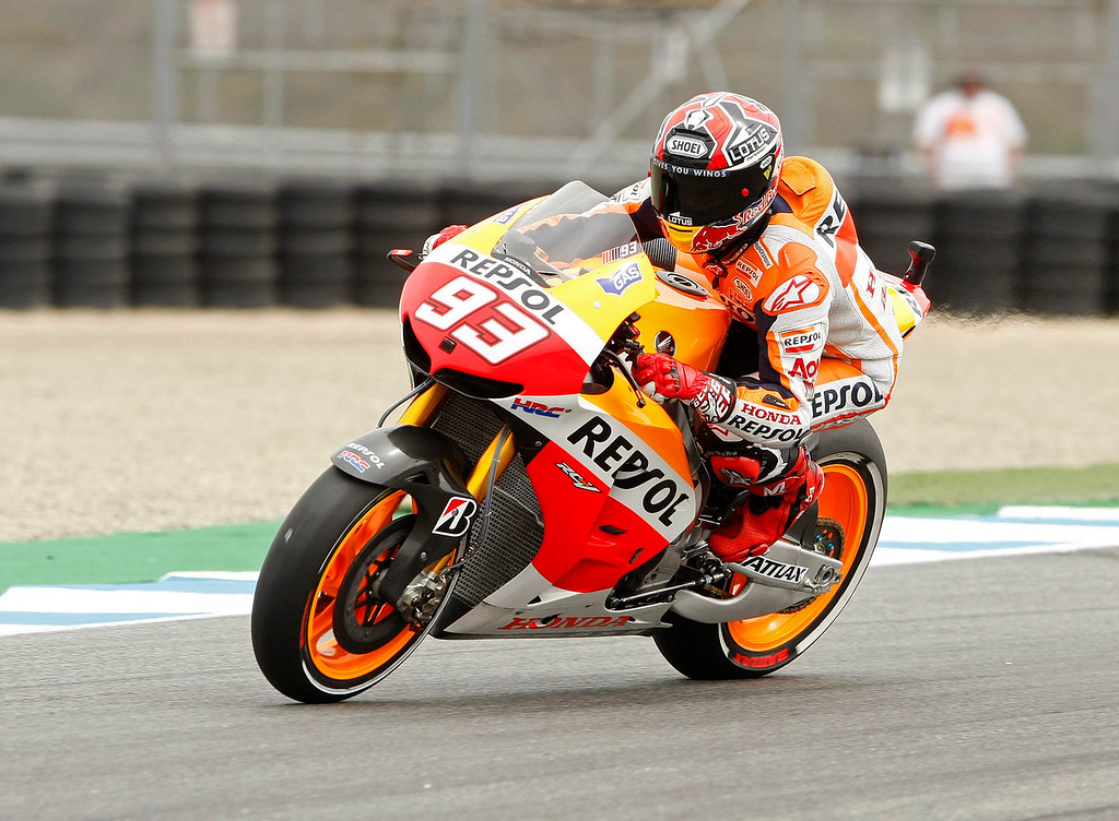 Description of . Current MotoGp points leader Marc Marquez from Spain, races out of turn-11 on his Repsol Honda Team RC213V at Mazda Raceway Laguna Seca during the first day of practice on July 19, 2013.  (Vern Fisher/Monterey County Herald)