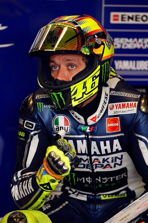 Description of . MotoGp rider Valentino Rossi from Italy, in the Yamaha Factory Team garage at Mazda Raceway Laguna Seca during the first day of practice on July 19, 2013.  (Vern Fisher/Monterey County Herald)