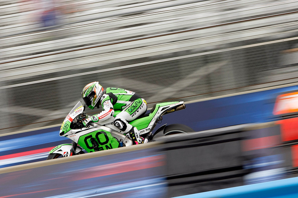 Description of . MotoGp rider Alvaro Bautista from Spain races down the straight away on his Go & Fun Honda Gresini Team RC213V/FTR Honda at Mazda Raceway Laguna Seca during the first day of practice on July 19, 2013.  (Vern Fisher/Monterey County Herald)