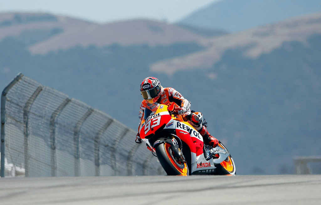 Description of . Current MotoGp points leader Marc Marquez from Spain, heading in to the corkscrew at Mazda Raceway Laguna Seca during the first day of practice on July 19, 2013.  (Vern Fisher/Monterey County Herald)