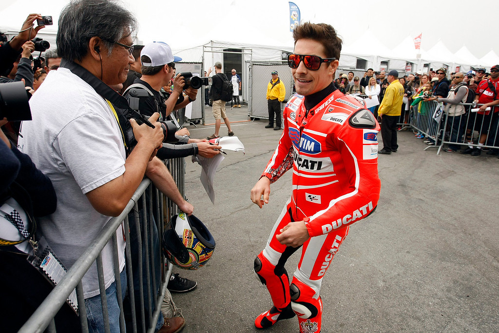 Description of . MotoGp rider Nicky Hayden from USA, talks with fans at Mazda Raceway Laguna Seca during the first day of practice on July 19, 2013.  (Vern Fisher/Monterey County Herald)