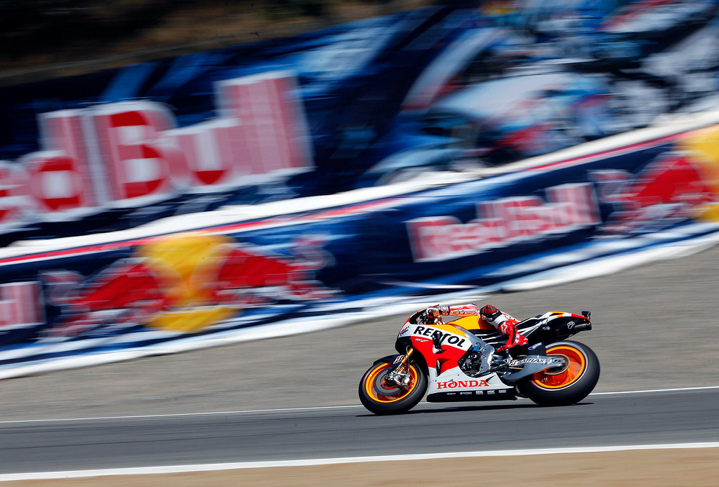 Description of . Marc Marquez from Spain in the corkscrew at Mazda Raceway Laguna Seca during the Red Bull U.S. Grand Prix in Monterey on July 21, 2013.  Marquez went on to win the race.  (Vern Fisher/Monterey County Herald)