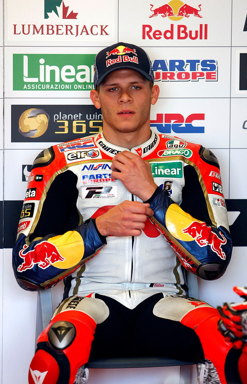 Description of . Stefan Bradl from Germany in the LCR Honda MotoGp garage, at Mazda Raceway Laguna Seca prior to the morning warm-up session for the Red Bull U.S. Grand Prix in Monterey on July 21, 2013.  (Vern Fisher/Monterey County Herald)