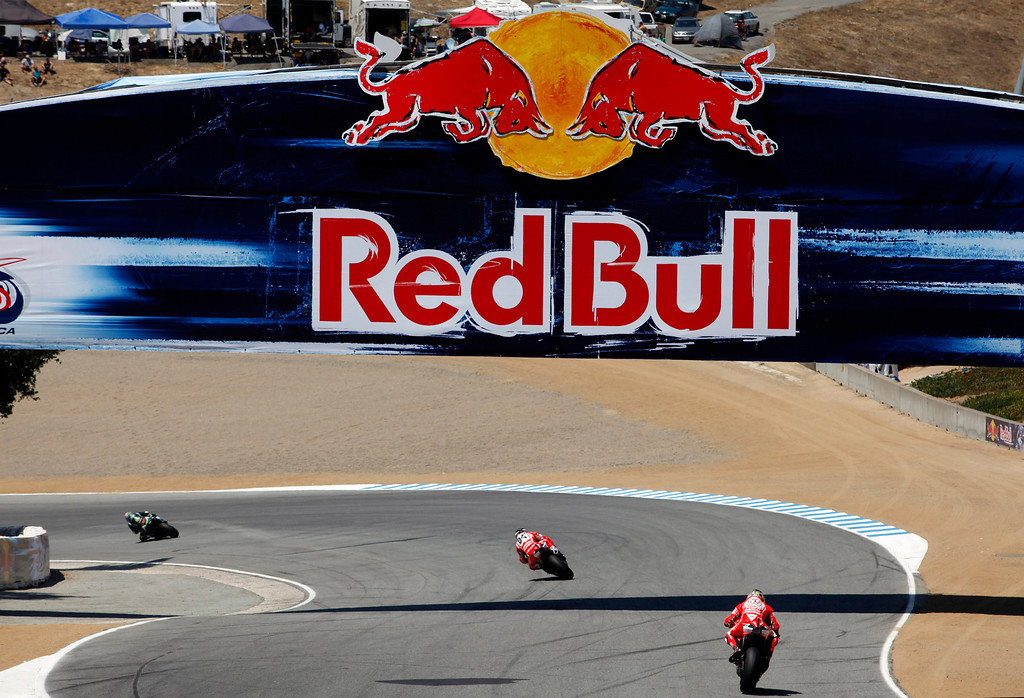 Description of . Riders exit the corkscrew at Mazda Raceway Laguna Seca during the Red Bull U.S. Grand Prix in Monterey on July 21, 2013.  Marc Marquez went on to win the race.  (Vern Fisher/Monterey County Herald)