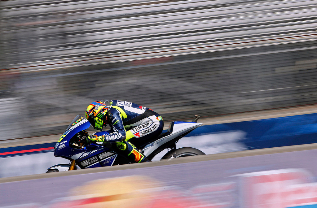 Description of . MotoGp rider Valentino Rossi from Italy, at Mazda Raceway Laguna Seca during the morning warm-up session for the Red Bull U.S. Grand Prix in Monterey on July 21, 2013.  (Vern Fisher/Monterey County Herald)