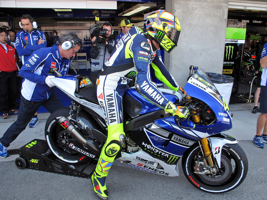Description of . Valentino Rossi from Italy gets on his Yamaha YZR M-1 at Mazda Raceway Laguna Seca for the morning warm-up session for the Red Bull U.S. Grand Prix in Monterey on July 21, 2013.  (Vern Fisher/Monterey County Herald)