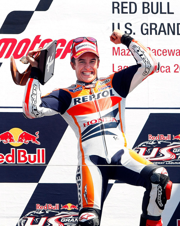 Description of . Marc Marquez from Spain on the podium at Mazda Raceway Laguna Seca during the Red Bull U.S. Grand Prix in Monterey on July 21, 2013.  Marquez went on to win the race.  (Vern Fisher/Monterey County Herald)