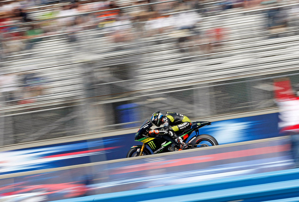 Description of . Bradley Smith from England, at Mazda Raceway Laguna Seca during the morning warm-up session for the Red Bull U.S. Grand Prix in Monterey on July 21, 2013.  (Vern Fisher/Monterey County Herald)