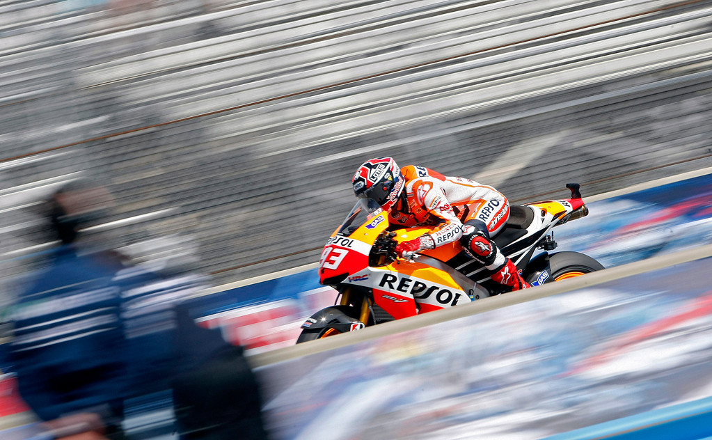 Description of . Marc Marquez from Spain races down the straight at Mazda Raceway Laguna Seca during the Red Bull U.S. Grand Prix in Monterey on July 21, 2013.  Marquez went on to win the race.  (Vern Fisher/Monterey County Herald)