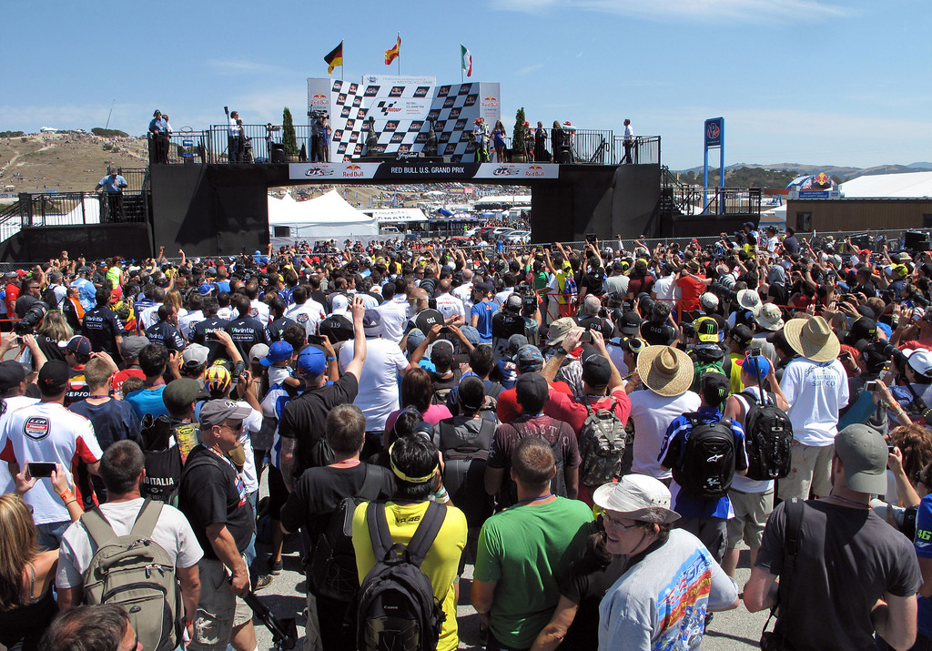 Description of . The scene at the winners podium at Mazda Raceway Laguna Seca during the Red Bull U.S. Grand Prix in Monterey on July 21, 2013.  Marc Marquez went on to win the race.  (Vern Fisher/Monterey County Herald)