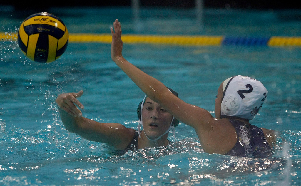 Description of . Colleen Mayone of Monterey and #2 Emily Rindermann of Salinas during the Monterey High vs. Salinas High girls water polo match on Oct. 22, 2013 at Santa Catalina School in Monterey.  (Vern Fisher/Monterey County Herald)