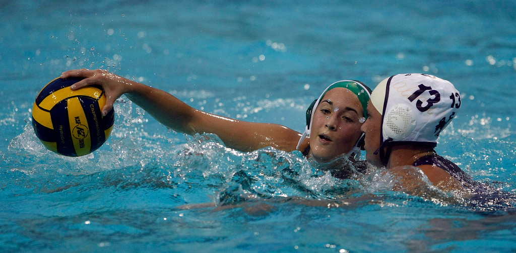 Description of . Action during the Monterey High vs. Salinas High girls water polo match on Oct. 22, 2013 at Santa Catalina School in Monterey.  (Vern Fisher/Monterey County Herald)