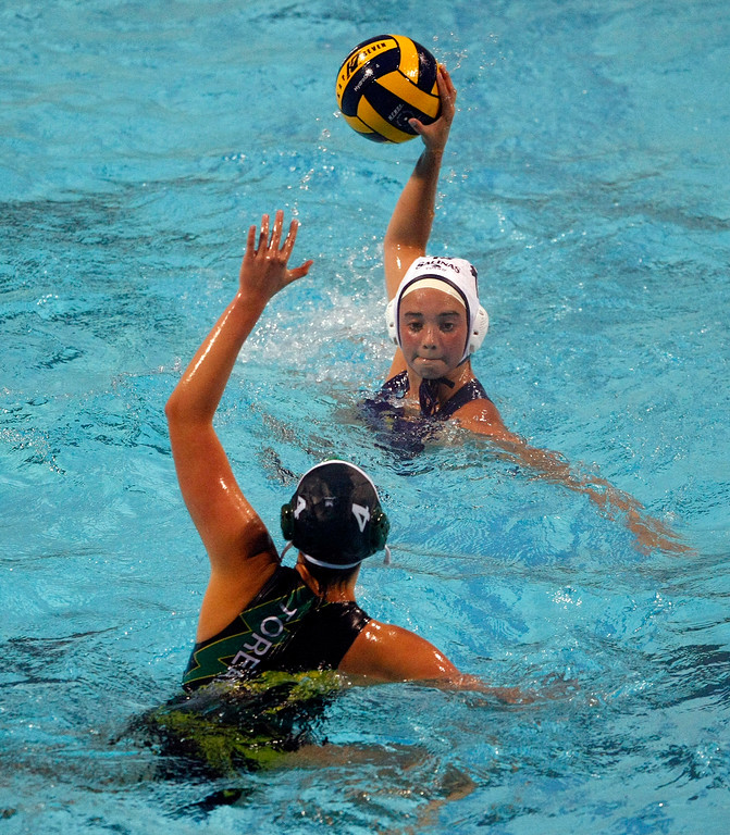 Description of . Salinas' #15 Sydney Clark tries to take a shot on goal as Monterey's #4 Colleen Mayone defends during their match on Oct. 22, 2013 at Santa Catalina School in Monterey.  (Vern Fisher/Monterey County Herald)