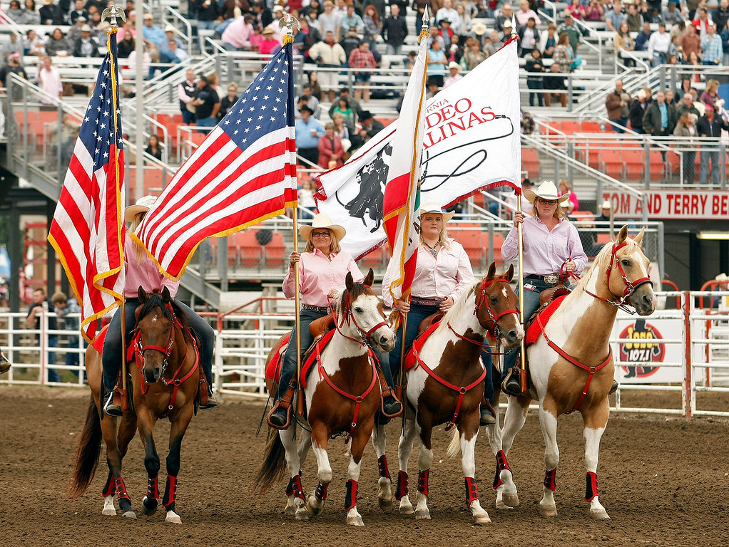 Description of . The Grand Entry at the California Rodeo Salinas on July 18, 2013.  (Vern Fisher/Monterey County Herald)