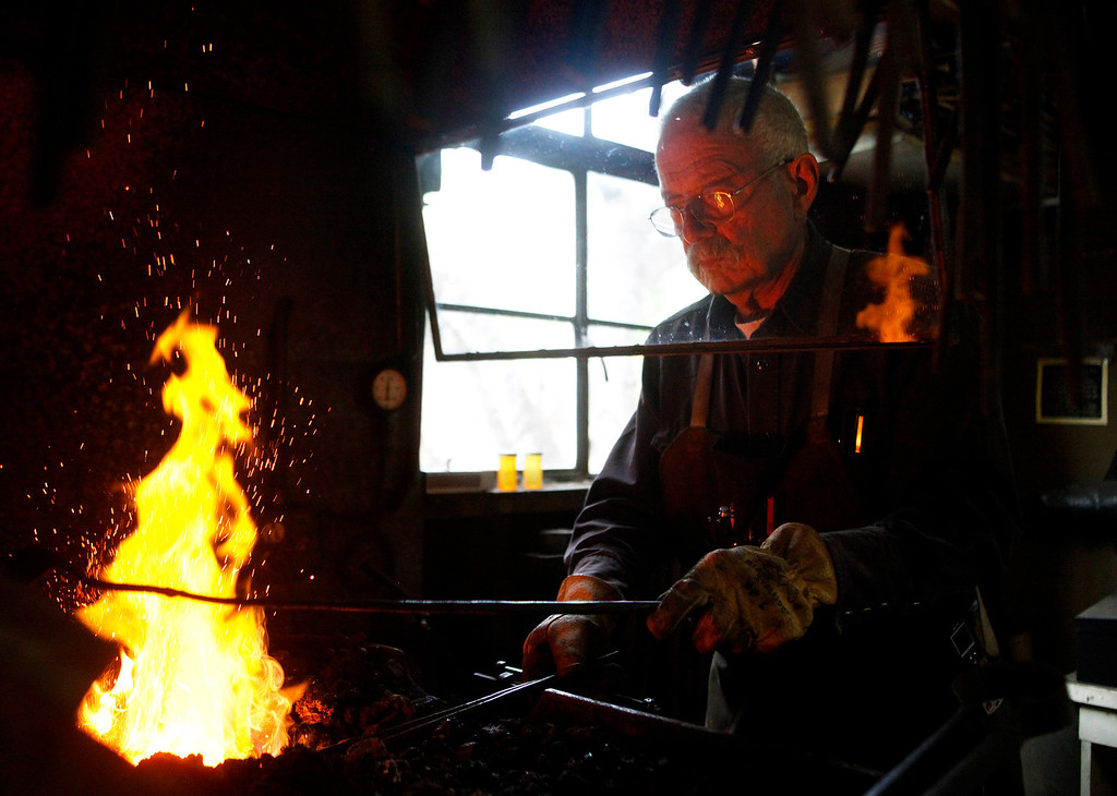 . Blacksmith John Hudson, 78, heats a piece of steel while working at his shop across from Point Lobos in Carmel, Calif. on Wednesday August 21, 2013.  (Photo David Royal/ Monterey County Herald)
