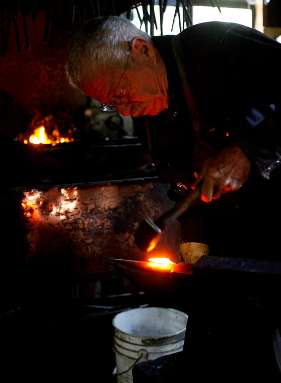 . Blacksmith John Hudson, 78, works on a piece of steel at his shop across from Point Lobos in Carmel, Calif. on Wednesday August 21, 2013.  (Photo David Royal/ Monterey County Herald)