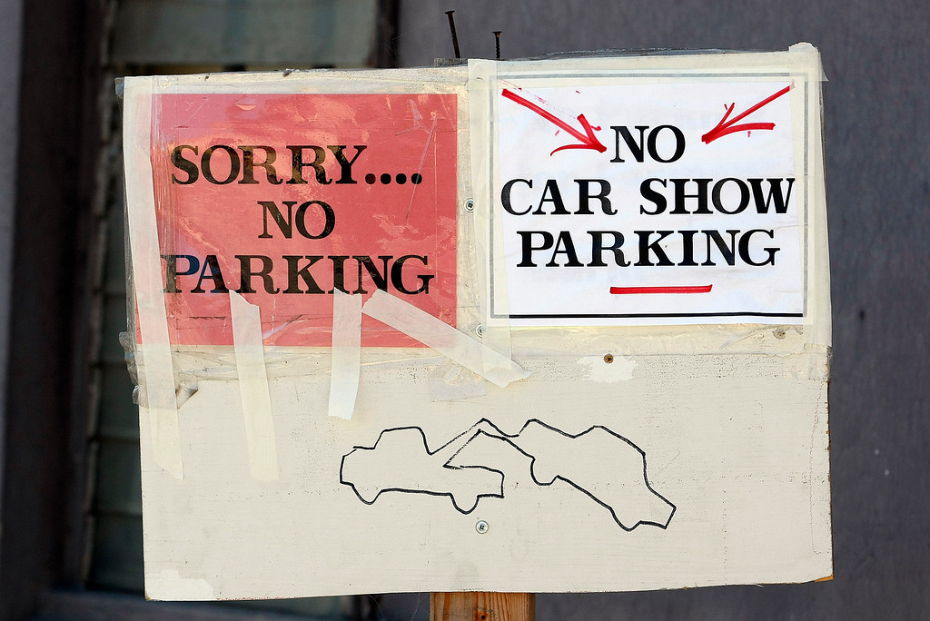 . A homemade no parking sign posted near The Little Car Show on Lighthouse Avenue in Pacific Grove on August 14, 2013.  (Vern Fisher/Monterey County Herald)