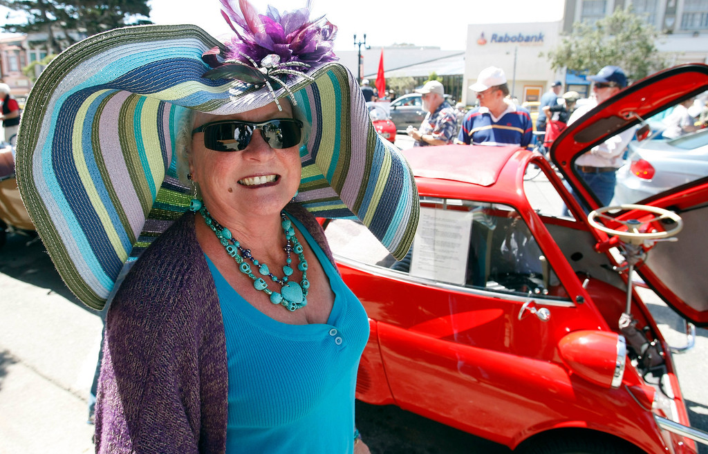 """. Cecelia Knauf with her 1958 BMW Isetta 300 that she named \""""BEEPOOP\"""" at The Little Car Show on Lighthouse Avenue in Pacific Grove on August 14, 2013.  (Vern Fisher/Monterey County Herald)"""
