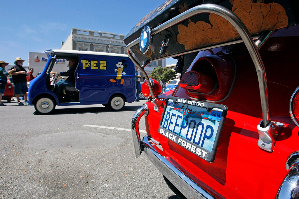 """. Vince Knauf shows off his 1958 BMW Isetta 300 \""""BEEPOOP\"""" at The Little Car Show on Lighthouse Avenue in Pacific Grove on August 14, 2013.  (Vern Fisher/Monterey County Herald)"""