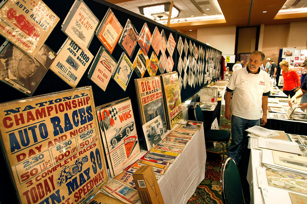 . Gary Booker of North Haven, CT works his booth at the Automobilia Monterey International Expo at the Embassy Suites in Seaside on August 13, 2013.  (Vern Fisher/Monterey County Herald)