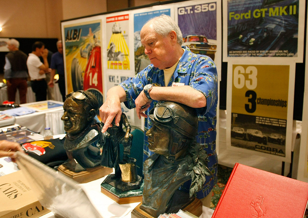 . Tony Singer works his booth at the Automobilia Monterey International Expo at the Embassy Suites in Seaside on August 13, 2013.  (Vern Fisher/Monterey County Herald)