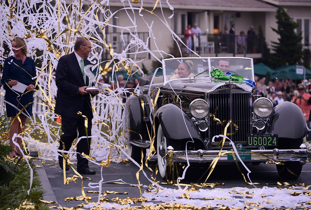 . Joseph Cassini\'s 1934 Packard Victoria Dietrich is awarded best in show at the 2013 Concours d\'Elegance at Pebble Beach golf course Sunday, August 18th, 2013. (Matthew Hintz/Monterey County Herald)