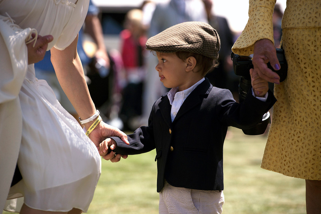 . Augustine Wasef walks holding his mother, Anna Wyckoff, and his grandmother, Wilhelmina\'s hands Sunday, August 18th, 2013 at the Concous d\'Elegance. (Matthew Hintz/Monterey County Herald)
