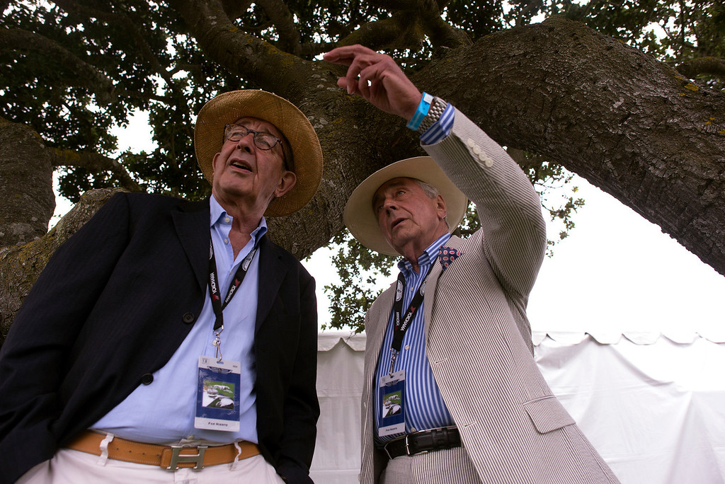 . Michael Broermann, left, and his friend Csaba Ajan watch from the crowd at the 2013 Concours d\'Elegance as awards are being given out Sunday, August 18th, 2013. (Matthew Hintz/Monterey County Herald)