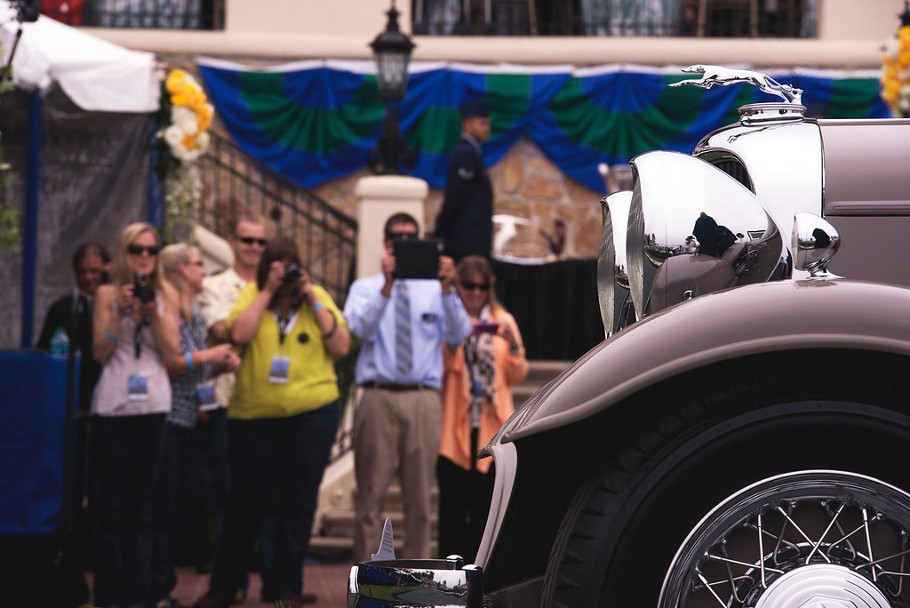 . Media line up to get shots as a 1929 Lincoln L Lebaron Aero Phaeton rolls across the stage at the 2013 Concours d\'Elegance. (Matthew Hintz/Monterey County Herald)