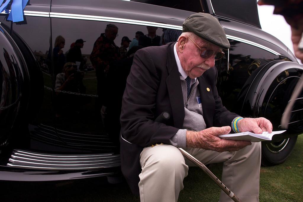 . Jack Bebee rests on the fender of his 1938 Buick Series 40 Lancefield Drophead Coupe. (Matthew Hintz/Monterey County Herald)