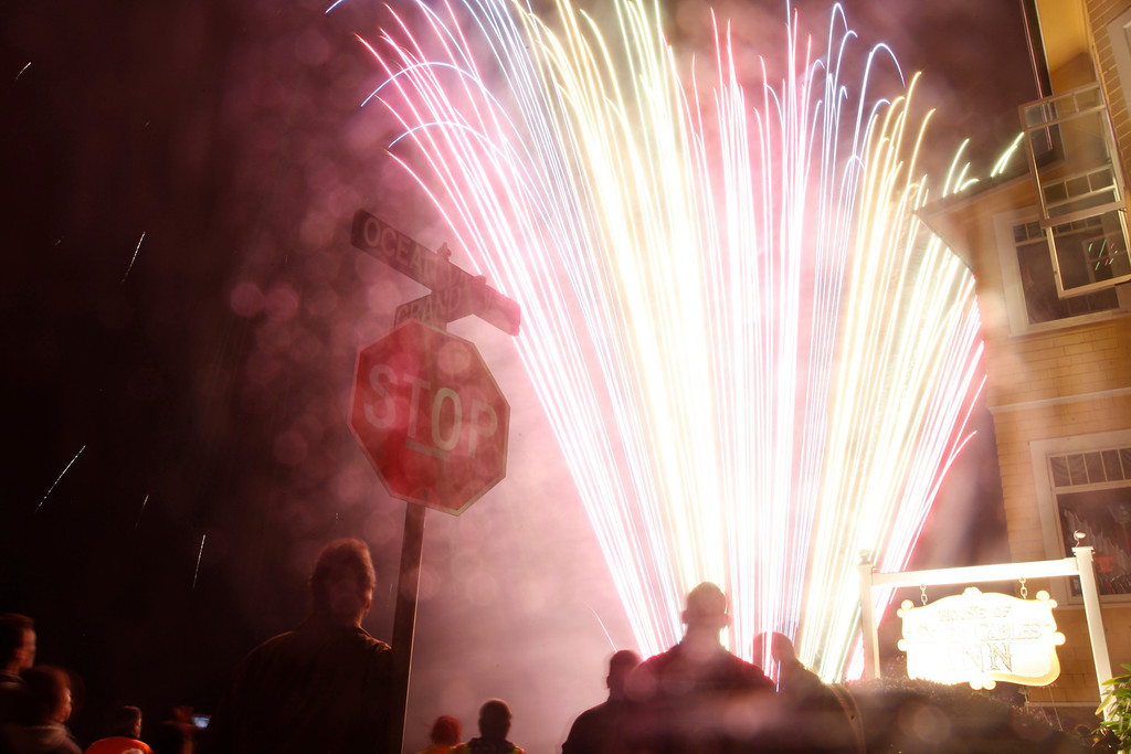 . People watch as fireworks go off during the Feast of Lanterns festivities at Ocean View Boulevard and Grand Avenue at Lovers Point Pacific Grove, Calif. on Saturday July 26, 2013.  (Photo David Royal/ Monterey County Herald)