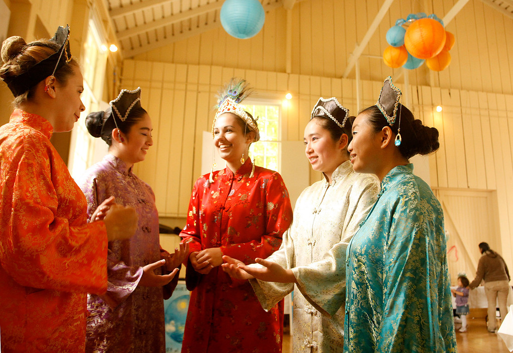 . Courtney Lyon, center, in red, Queen of the Feast of Lanterns speaks with her Royal Court composed of Caroline Gruber, left, as Princess Ruby, left, Hayley Yukihiro as Princess Amethyst, Ashley Yukihiro as Princess Pearl and Minhee Cho as Princess Turquoise during the Feast Of Flavors lunch at Chautauqua Hall in Pacific Grove, Calif. on Thursday July 25, 2013. The lunch showcases dishes donated by local restaurants with proceeds going to scholarships for the members of the Royal Court. (Photo David Royal/ Monterey County Herald)