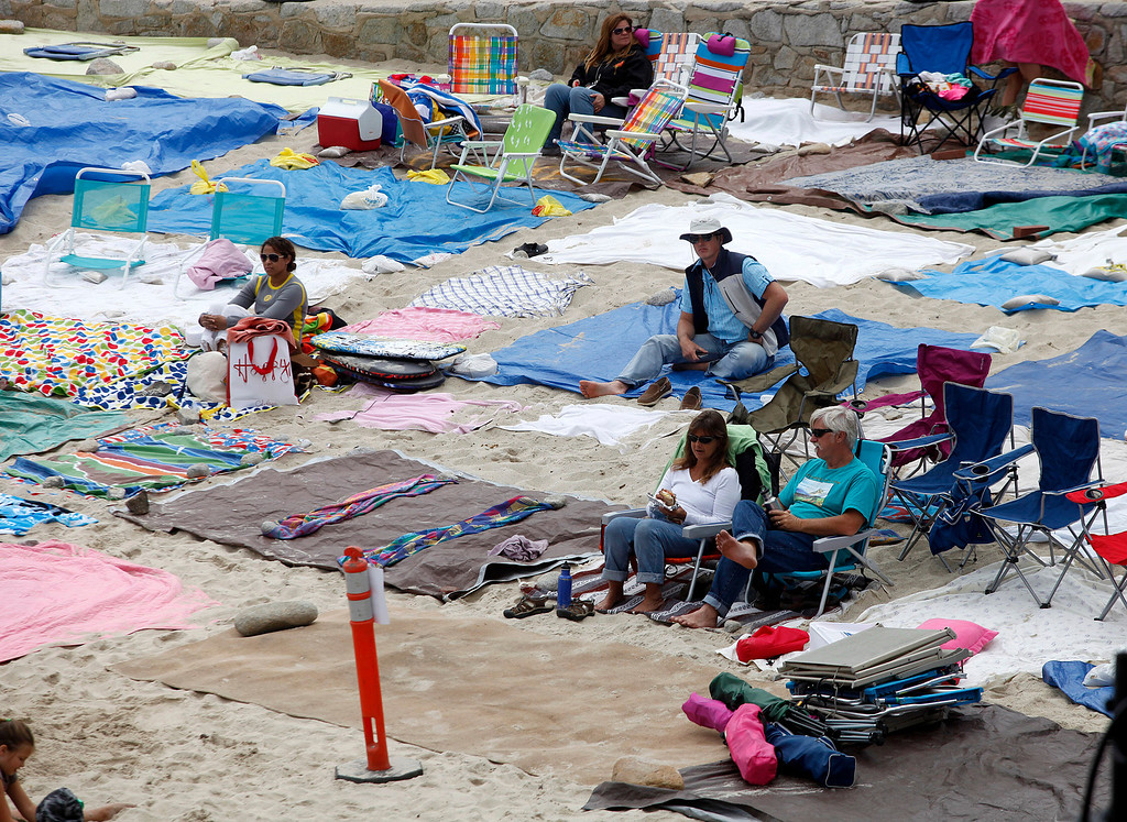 . Gina Gregory, center foreground, and her husband Barry Gregory sat in a spot they staked out with a blanket Friday evening during Feast of Lanterns festivities at Lovers Point Pacific Grove, Calif. on Saturday July 26, 2013.  (Photo David Royal/ Monterey County Herald)