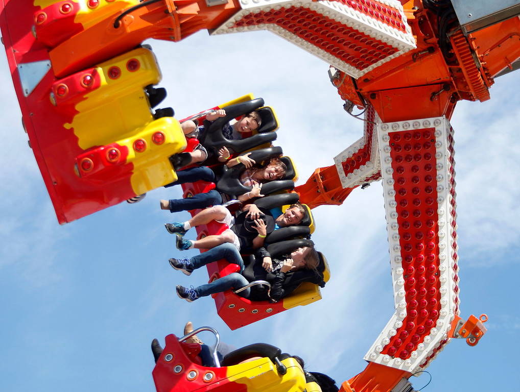. Bridget Brulc, 15, second from left, rides the Star Dancer with Joey Hipol, 11, left, and his brother Dylan, 17, and sister Samantha, 14, at the Monterey County Fair in Monterey, Calif. on Sunday September 1, 2013.  (Photo David Royal/ Monterey County Herald)