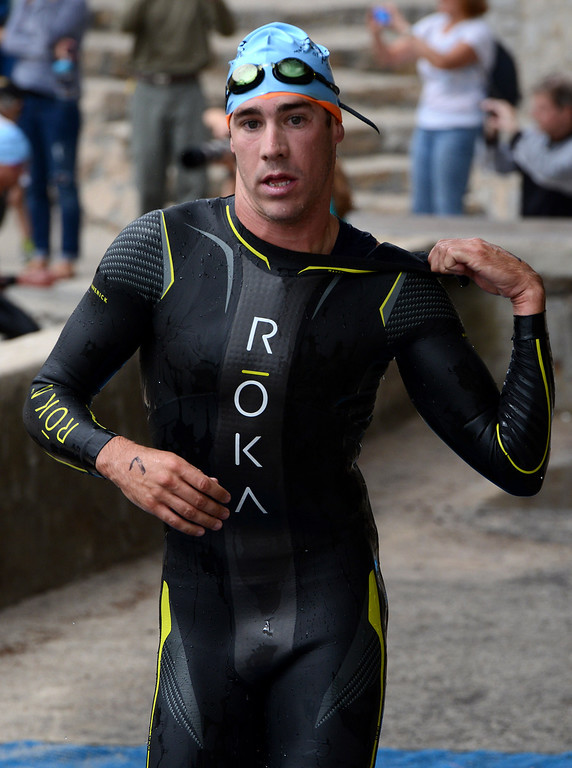 . Mens winner Tommy Zaferes of Aptos, Calif. transitions from the swim to his bicycle during the Elite Race at the Pacific Grove Triathlon in Pacific Grove, Calif. on Saturday September 14, 2013.  Photo David Royal/ Monterey County Herald)