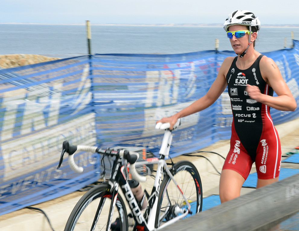 . Womens winner Radka Vodickova of Czechoslovakia transitions to her bicycle during the Elite Race at the Pacific Grove Triathlon in Pacific Grove, Calif. on Saturday September 14, 2013.  Photo David Royal/ Monterey County Herald)