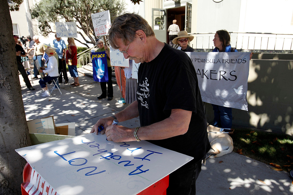 . Tom Shields from Moss Landing makes his own sign (not another Iraq) as he participates with the Peace Coalition of Monterey County in a demonstration in Salinas on September 4, 2013 against possible US military action in Syria.  (Vern Fisher/Monterey County Herald)