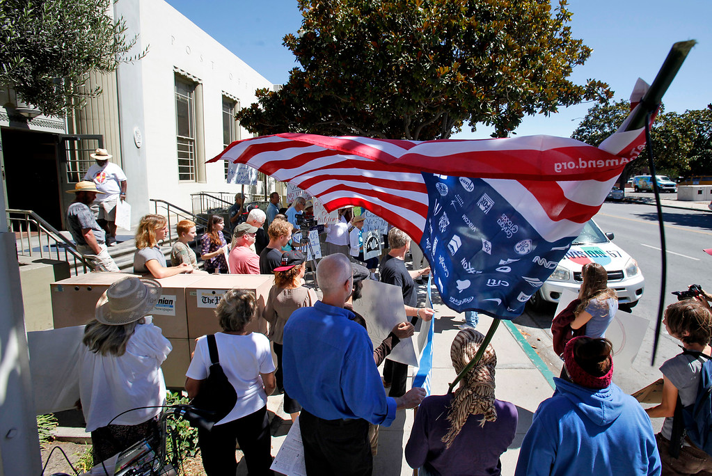 . Approximately thirty people joined with the Peace Coalition of Monterey County in a demonstration in Salinas on September 4, 2013 against possible US military action in Syria.  (Vern Fisher/Monterey County Herald)